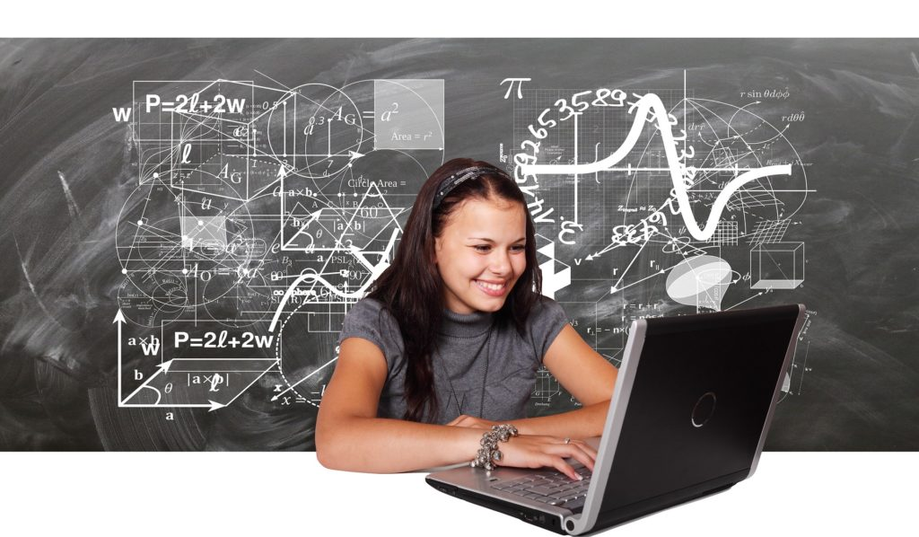happy student accessing any site she wants on a laptop with a VPN connection